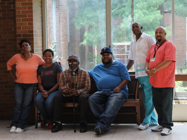"""""""Mr. Sam"""" with some of the staff at RHD Fernwood. From left are Joyce Harris, Gennefer Hall, Sam Foster, James Johnson, Eugene Green, and John Cain. The staff worked to help 82-year-old Mr. Sam achieve his goal of going home to his family. (Photo courtesy of One Step Away)"""