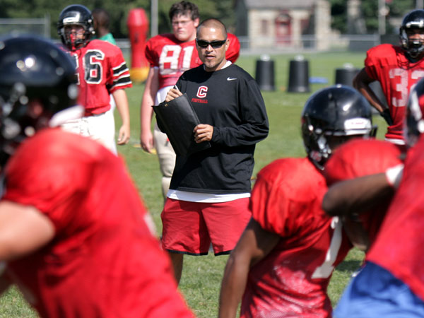Coatesville football coach Matt Ortega (center) watches a play during practice. (LOU RABITO / Staff)