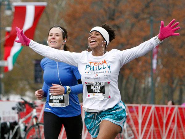 A runner reacts as she approaches the finish line of the Philadelphia Marathon, Sunday, Nov. 18, 2012, in Philadelphia. (AP Photo/ Joseph Kaczmarek)