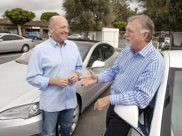 Jerry Dunton, left, and Dick Kaiser are friends who both own Tesla Model S cars. They are shown at a new Supercharger station that will open soon in San Juan Capistrano, Calif., on Jan. 31, 2014. (Ken Steinhardt/Orange County Register/MCT)