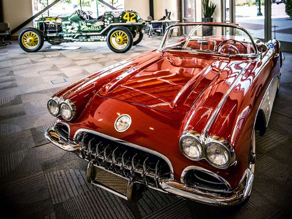 In the background is a 1917 Peerless Speedster and in the foreground is a 1959 Chevrolet Corvette in the lobby of the Hagerty Insurance Company in Traverse City, Mich., on July 31, 2014. (J. Gabriel Augustine/Hagerty Insurance Company/MCT)