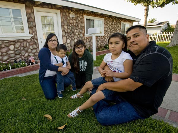 Carlos Jijon, right, and his wife Cinthya pose for a photo with their three children: Emmanuel, 15 months, Natalie, 14, and Danica, 5. The couple recently bought this home in Buena Park, Calif. (Paul Rodriguez/Orange County Register/MCT)