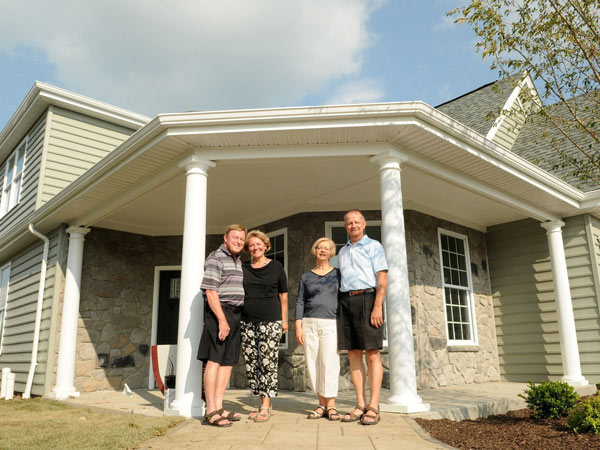 From left, John and Judy Woffington join Rich and Kathy Jucha outside a model home in a Traditions of America housing development called Sewickley Ridge in Ohio Township, Pa., on June 24, 2014. (Connor Mulvaney/Pittsburgh Post-Gazette/MCT)