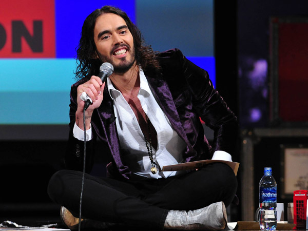 "This March 14, 2013 photo released by FX shows Russell Brand, host of the FX series ""Brand X with Russell Brand."" The British comedian announced Thursday, June 6, that he´s launching a world comedy tour focusing on Che Guevara, Gandhi, Malcolm X and Jesus Christ. Brand says the show examines �the importance of heroes in this age of atheistic disposability.�  The �Messiah Complex� tour is set to begin August 15 in Abu Dhabi and wrap up Dec. 9 in Iceland. (AP Photo/FX, Ellis O´Brien)"