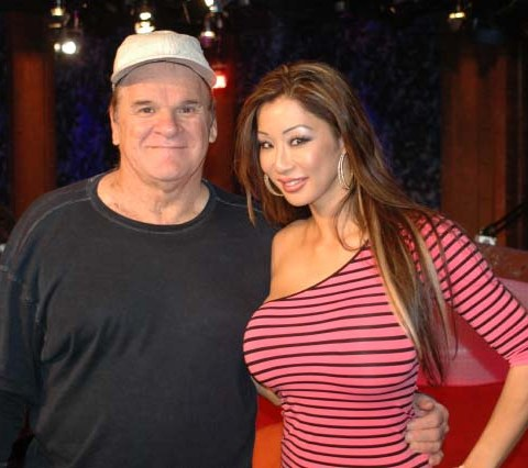 Pete Rose and Kiana Kim photographed after an April 2010 appearance on The Howard Stern Show.