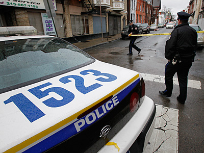 Philadelphia police at the scene of an fire along Foulkrod St. at Griscom St. on Thursday morning. December 27, 2012