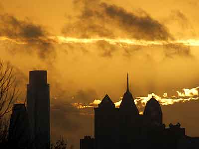 A Philadelphia sunrise, as seen from Lancaster Avenue and 59th Street, casting an orange glow Nov. 29, 2011. (Michael S. Wirtz / Staff Photographer)
