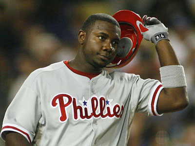 Ryan Howard reacts after striking out in the third inning last night. (AP Photo/Gus Ruelas)