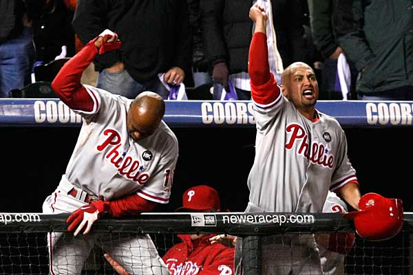 Jimmy Rollins and Shane Victorino celebrate after Jayson Werth drove in Ryan Howard for the winning run in the 9th inning in Game 4 of the National League Division Series against Colorado. (Ron Cortes/Staff Photographer)