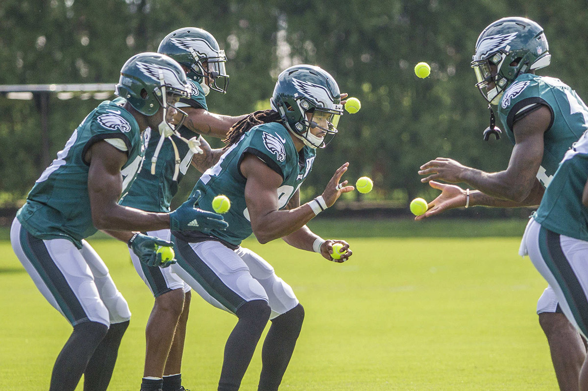 Eagles wide receivers toss tennis balls to each other during a drill at practice Sunday, August 13, 2017.