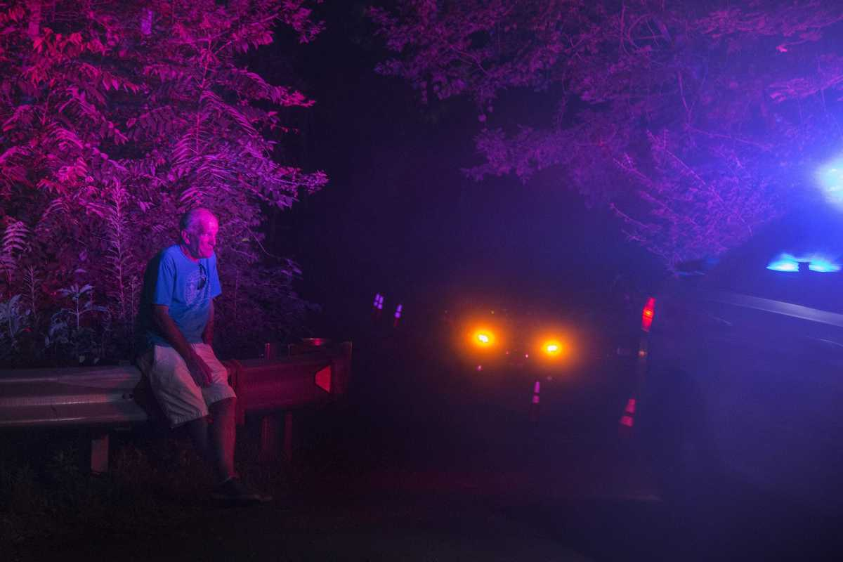 Police activity continues into the night Wednesday, July 12, 2017 as friends and family keep vigil for a third day at the DiNardo family farm in Solebury where investigators have been digging and searching for clues into the disappearance of four young Bucks County men.