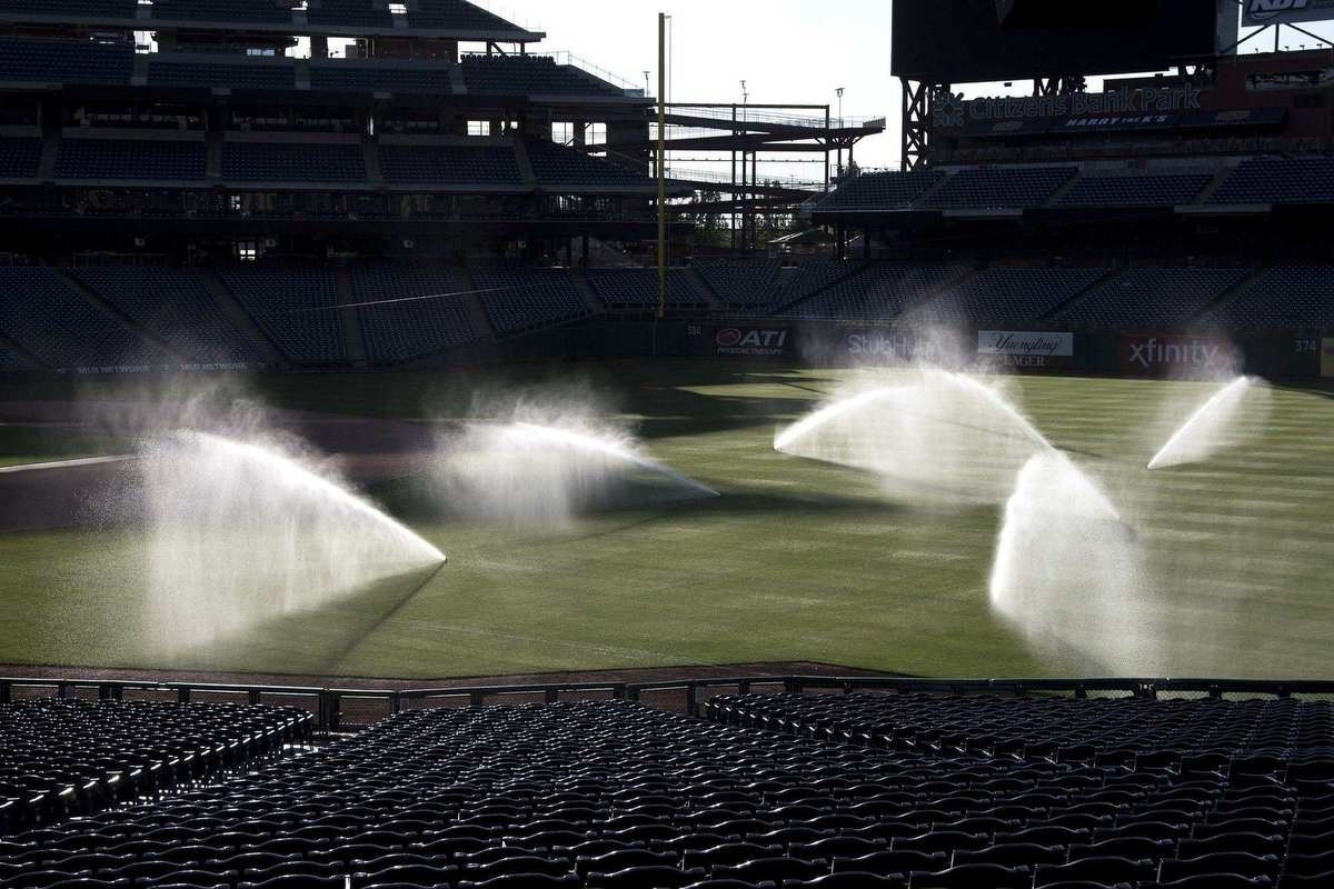 Sprinklers cool the outfield at Citizens Bank Park. Head groundskeeper Mike Beokholder says there are 12 moisture sensors buried throughout the field monitoring moisture levels and they typically water the grass for 20 minutes per zone when the temperature reaches 90 degrees.