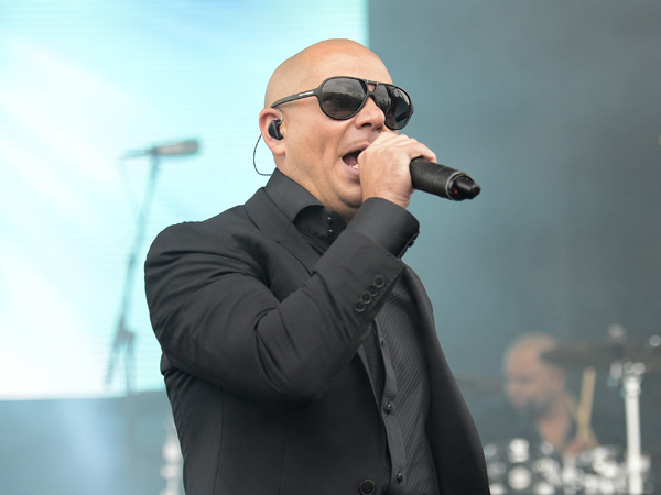 Pitbull performs at Pimlico Race Course, Saturday, May 18, 2013, in Baltimore. (AP Photo/Nick Wass)
