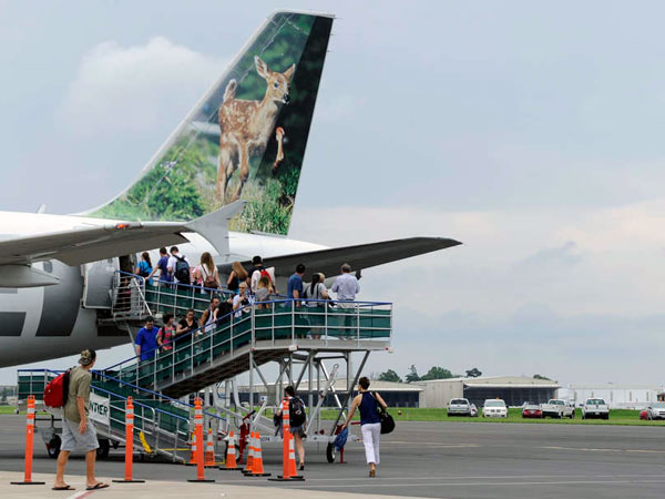 Passengers board a Frontier flight at Trenton-Mercer Airport. Frontier has trimmed some Trenton flights.
