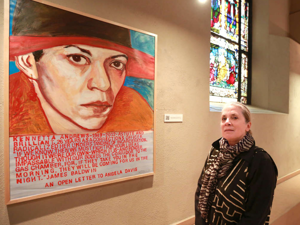 Artist Mary DeWitt, a longtime prison volunteer, with her portrait of inmate Kennetta Andrews.