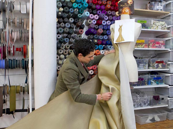 Fashion designer Zac Posen during the creative process of designing his first 24k gold dress inspired by new MAGNUM Gold?! Ice Cream. The dress will be unveiled at the premiere of the MAGNUM short film &acute;As Good As Gold&acute; during the Tribeca Film Festival April 18, 2013.  (Mark Von Holden/Invision for Magnum Ice Cream). <br />