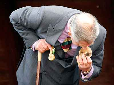 Britain´s Prince Charles checking the smell of a mushroom during a visit to Japan in 2008. This veteran farmer writes about producing food for the future. (AP Photos/Issei Kato, Pool)