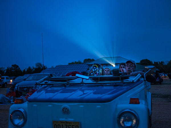 Bill Phifer and his family enjoy a movie from their convertible at the Delsea Drive-In, in Vineland, New Jersey on Friday, May 9, 2014. The theater shows two double features on separate screens starting just past sundown. ( Matthew Hall / Staff Photographer )