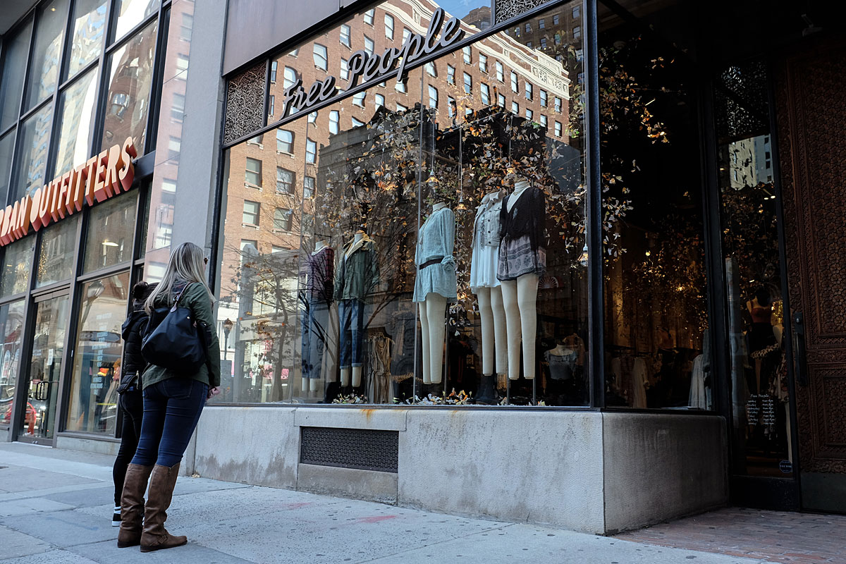 Courtney Fairfield, 24, looks over the center city Free People window display with her friend Dana Daniels, 25.