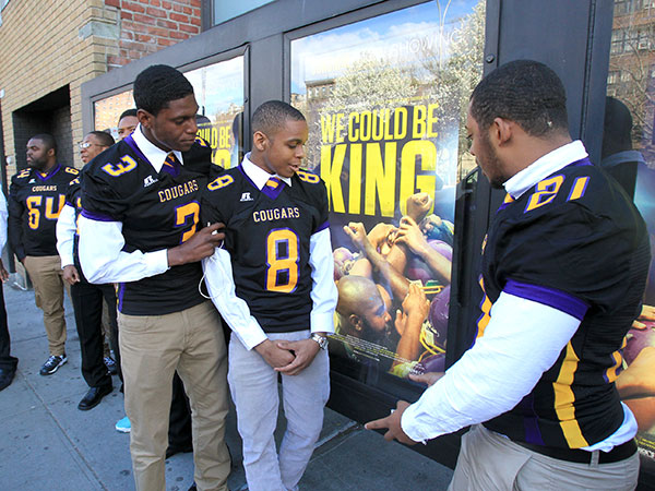 "(Left to right) D.J. Brinkley, Emmanuel Clark, and Joseph Walker, members of the Martin Luther King High School football team, check out movie posters outside of Sunshine Cinema in lower Manhattan. The premiere of ""We Could Be King "" was held during the Tribeca Film Festival on Wed, April 23, 2014. ( CHARLES FOX / Staff Photographer )"