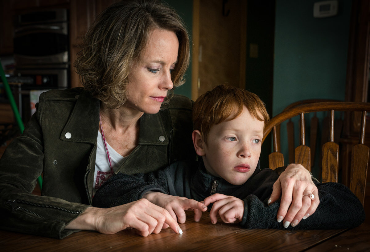 Collin and her son Lucas Sims in their home, in Philadelphia, April 2, 2018. JESSICA GRIFFIN / Staff Photographer.