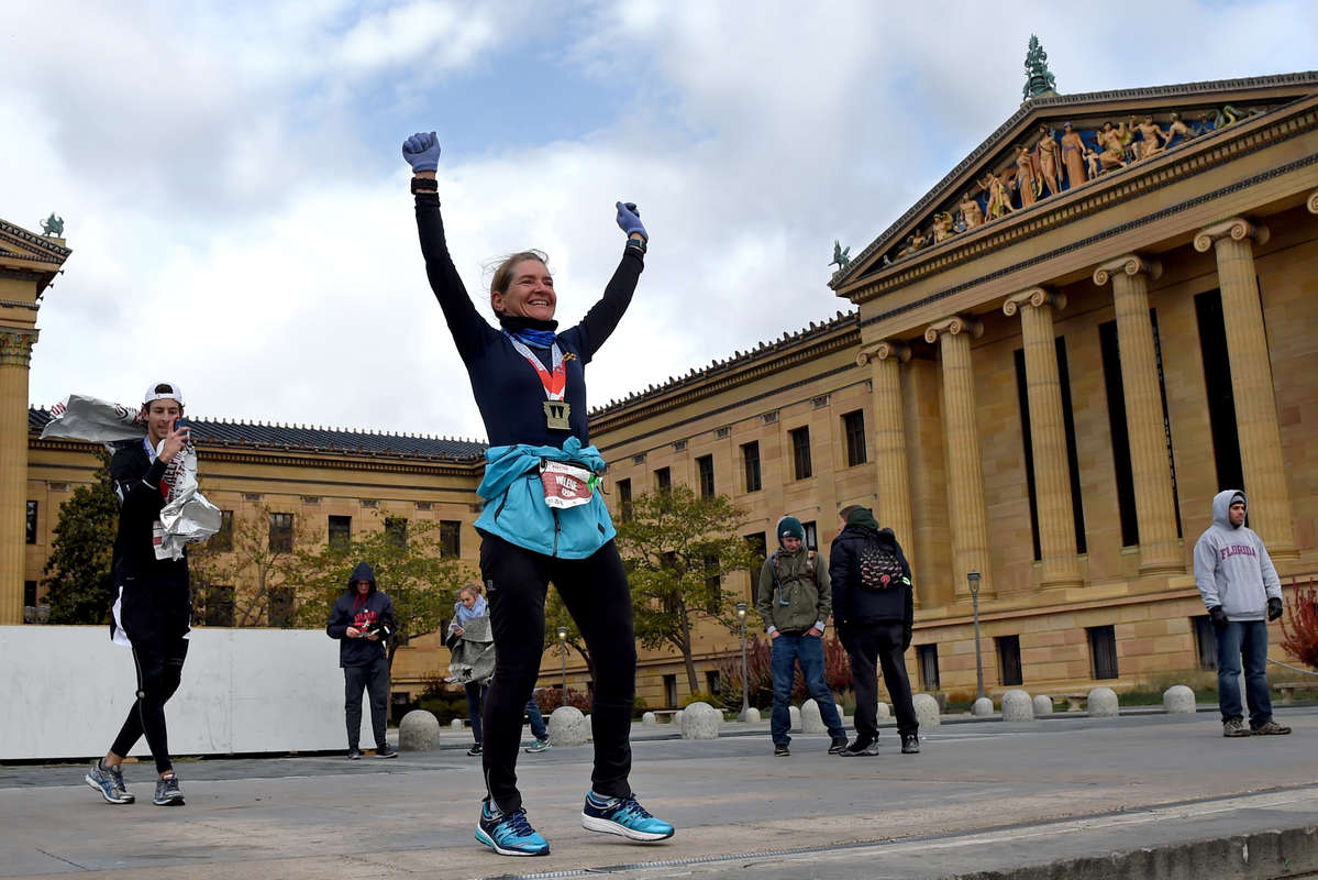 On the day before the 40th anniversary of the classic movie, Helene Fortier (right), 52, of Ottawa, Canada celebrates Rocky-style on the top of the Philadelphia Museum of Art steps as David Hauser (left), 22, of Manhattan, N.Y. photographers her after they completed the Philadelphia Marathon November 20, 2016. Hauser was running in his first Marathon. Fortier met and ran with him and his friend from about mile 14, with the two young men providing her with a windbreak. Both claimed Ricky was their favorite movie.