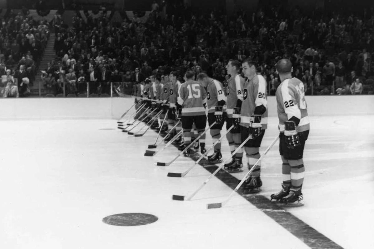The Philadelphia Flyers line up on the blue line prior to their first game at the Spectrum on Oct. 19, 1967. None of the players in this photo wore helmets on Oct. 19, 1967 and Penguins goalie Les Binkley did not wear a mask.<br />