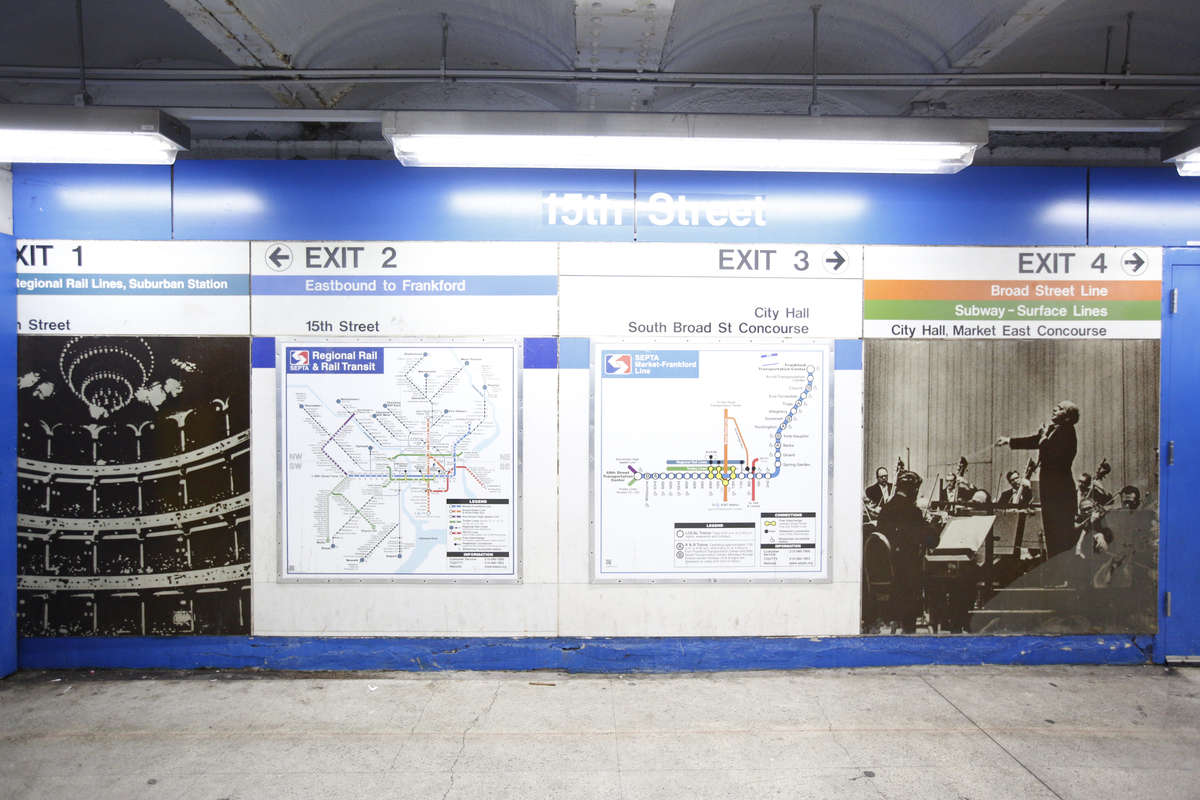 SEPTA will soon cover up these two photo panels on the west-bound platform of the Market-Frankford Line 15th Street Station. One is of the Academy of Music and is already partially covered by a wall, and the other, of Eugene Ormandy leading the Philadelphia Orchestra, is damaged.