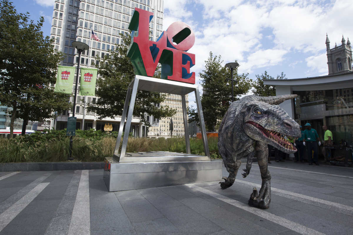 "A raptor hung out around Philly landmarks to promote ""Jurassic World: The Exhibition,"" at the Franklin Institute starting Nov. 25."