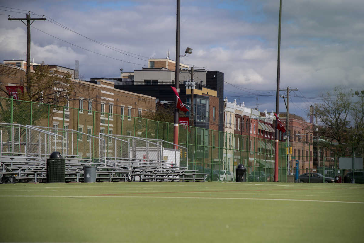 This astroturf athletic field east of N. 16th is part of the site where Temple University wants to build a stadium.  The homes on the left side of the image, including a nursing home (the first building on left of frame with the horizontal white stripes - Inga references it) are on north side of Norris St. between N. 16th and N. Broad St.  Photo taken October 25, 2016.    CLEM MURRAY / Staff Photographer