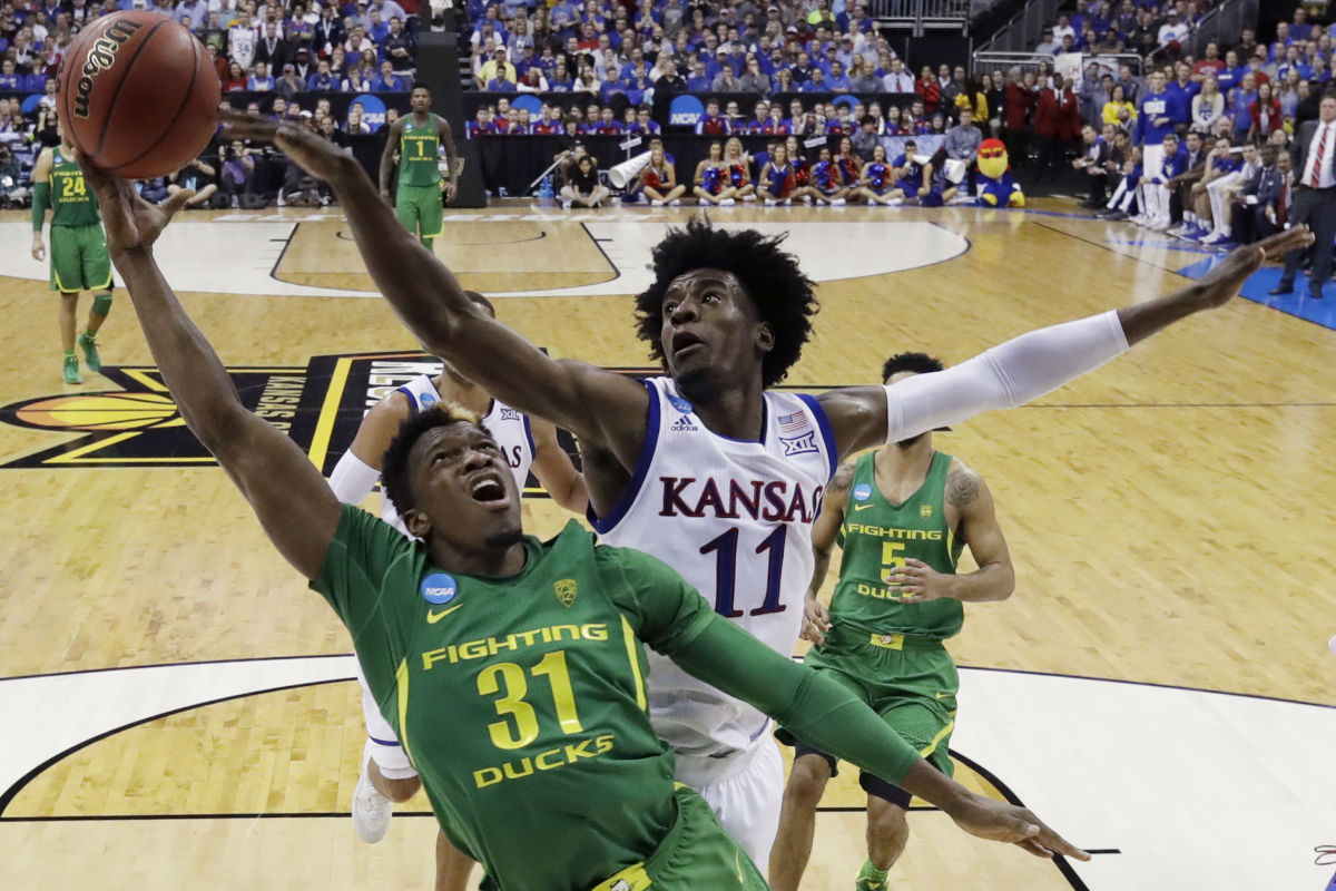 Oregon guard Dylan Ennis (31) drives to the basket ahead of Kansas guard Josh Jackson during the second half Saturday, March 25, 2017. Jackson is among the top prospects for the June 22 NBA draft.