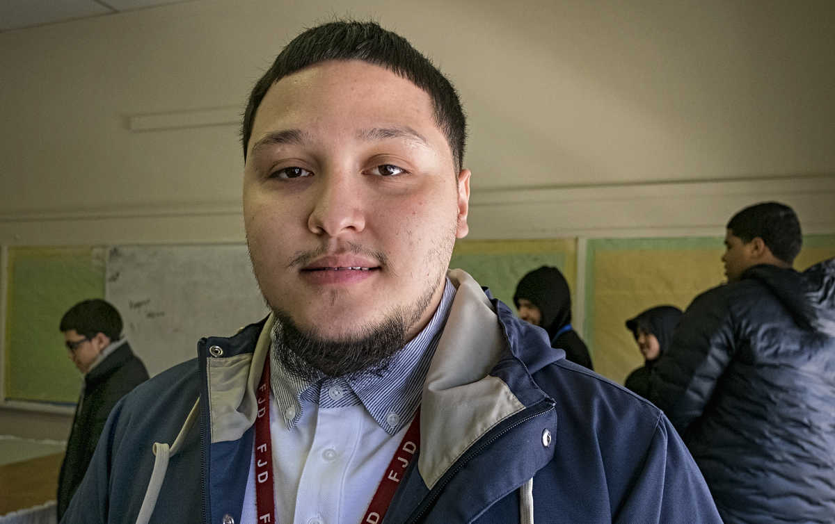 Ryan Rivera overcame a troubled youth and now dreams of being a police officer. He&amp;#039;s shown here at El Centro de Estudiantes, his former school, where he returns often to mentor other students.  ED HILLE / Staff Photographer<br />