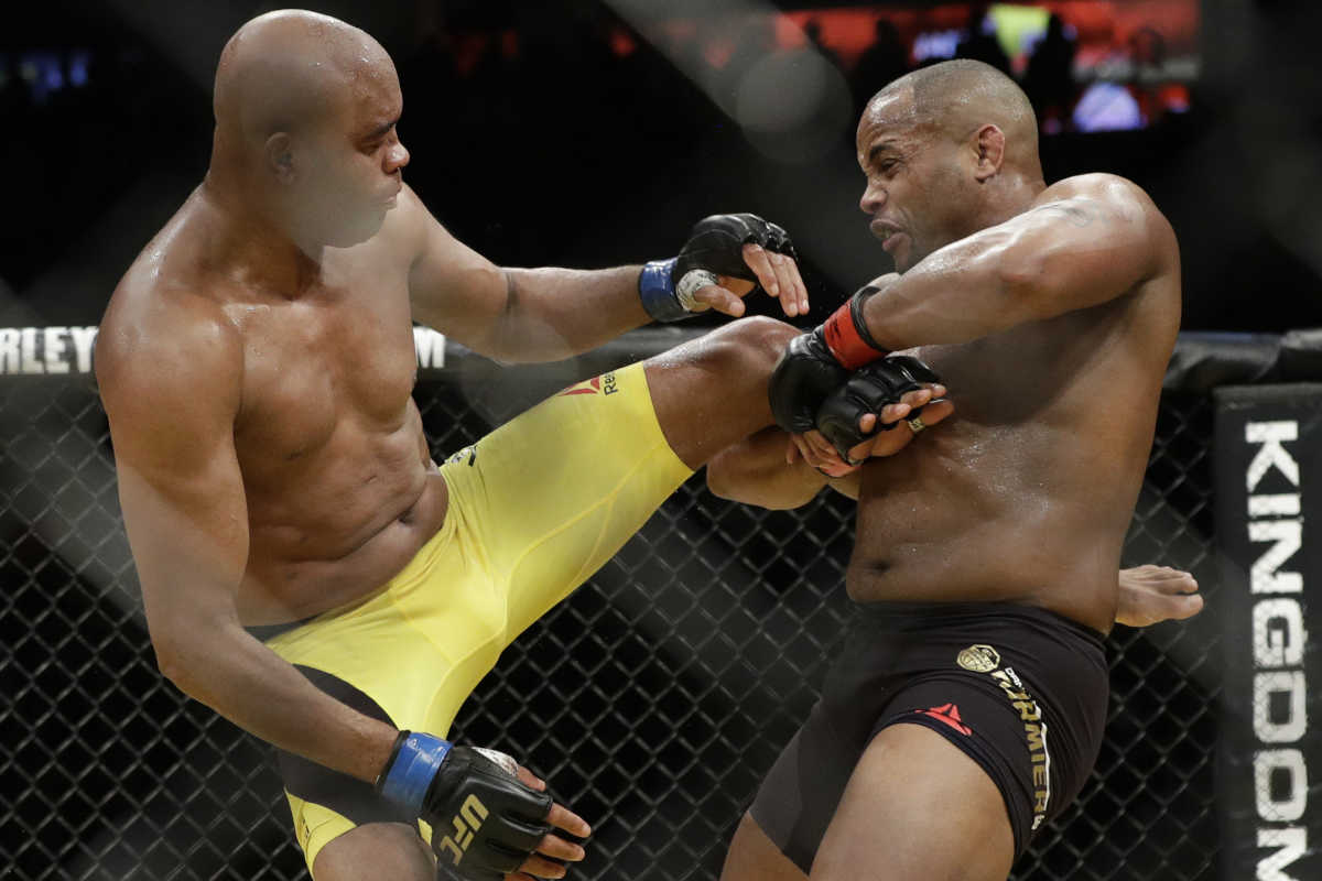 Daniel Cormier, right, fights Anderson Silva during their light heavyweight mixed martial arts bout at UFC 200 last July in Las Vegas.