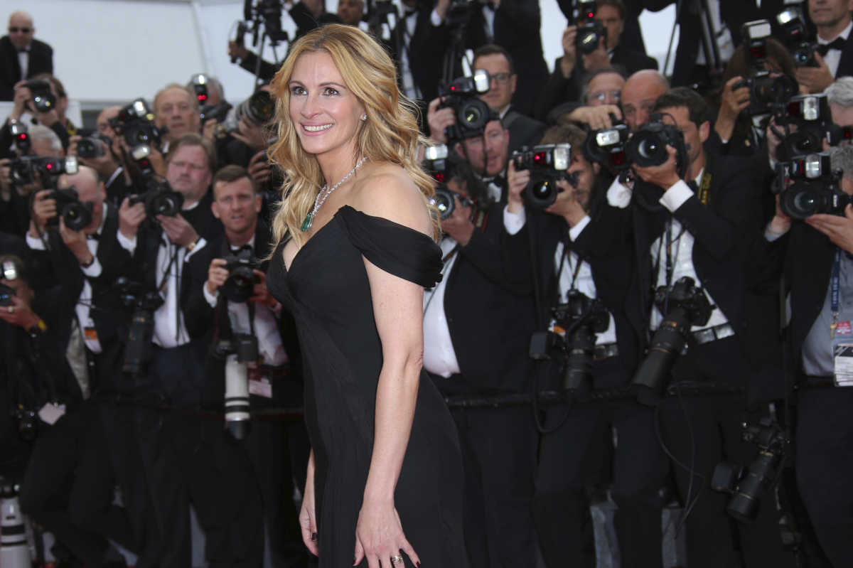 "In this Thursday, May 12, 2016, file photo, Actress Julia Roberts poses for photographers upon arrival for the screening of the film Money Monster at the 69th international film festival, Cannes, southern France. Roberts is more than just a ""Pretty Woman."" People magazine has named her the ""World's Most Beautiful Woman"" announced Wednesday, April 19, 2017."
