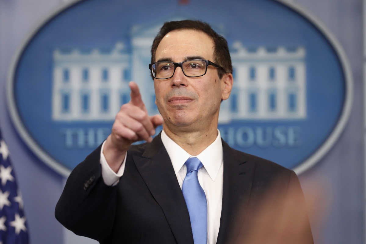Treasury Secretary Steve Mnuchin points to a member of the media as he answers questions during the daily briefing in the Brady Press Briefing Room of the White House on Monday.<br />