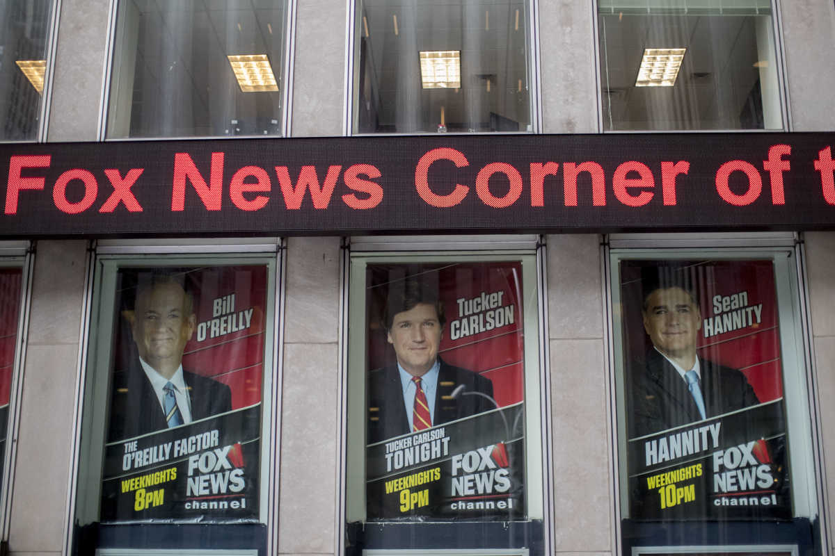 Posters featuring Fox News talent are displayed on the News Corp. headquarters building in Midtown Manhattan in April 2017.