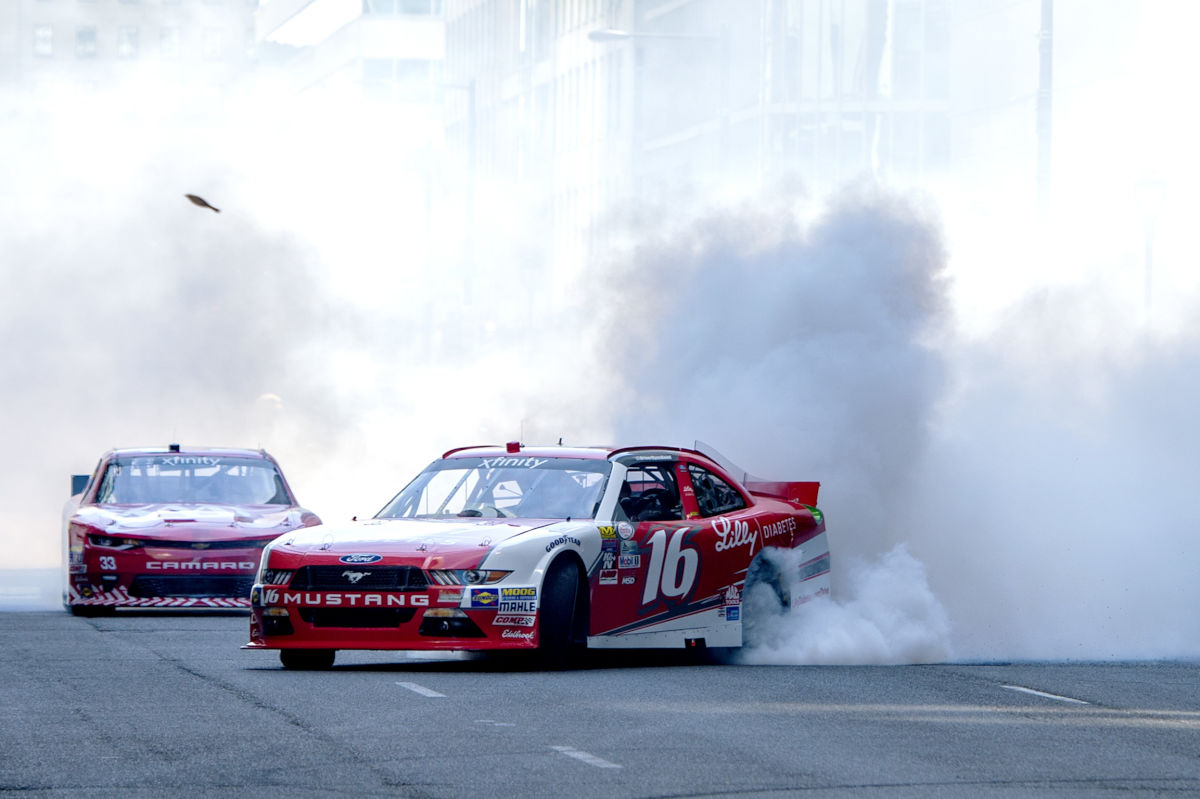 NASCAR promotes its Xfinity Series with a parade of cars through Center City, including burnouts on the 1800 block of JFK Boulevard, on Tuesday.