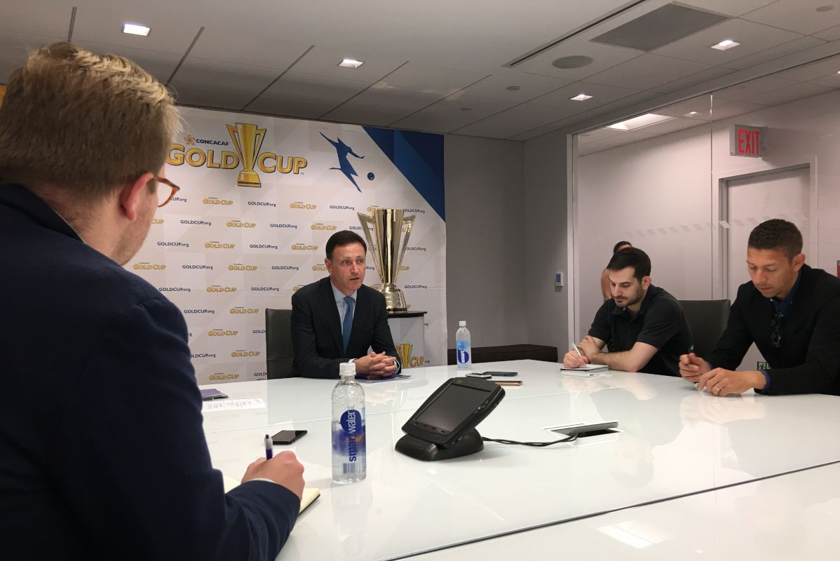 CONCACAF Secretary General Philippe Moggio (the guy in the suit, of course) met with a group of reporters on Wednesday at Major League Soccer´s headquarters in New York. I didn´t make it into the photo, which isn´t the worst thing.
