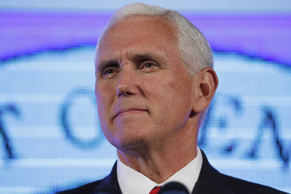 """Vice President Mike Pence pauses while speaking Thursday at the U.S. Chamber of Commerce during their """"Invest in America!"""" Summit in Washington."""