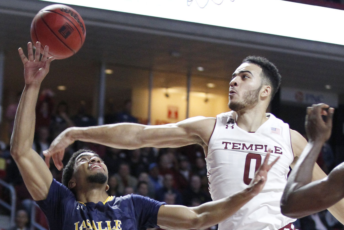 Temple's Obi Enechionyia, blocking a shot by Pookie Powell (left) of La Salle on Nov. 11, 2016, will return for his senior season.
