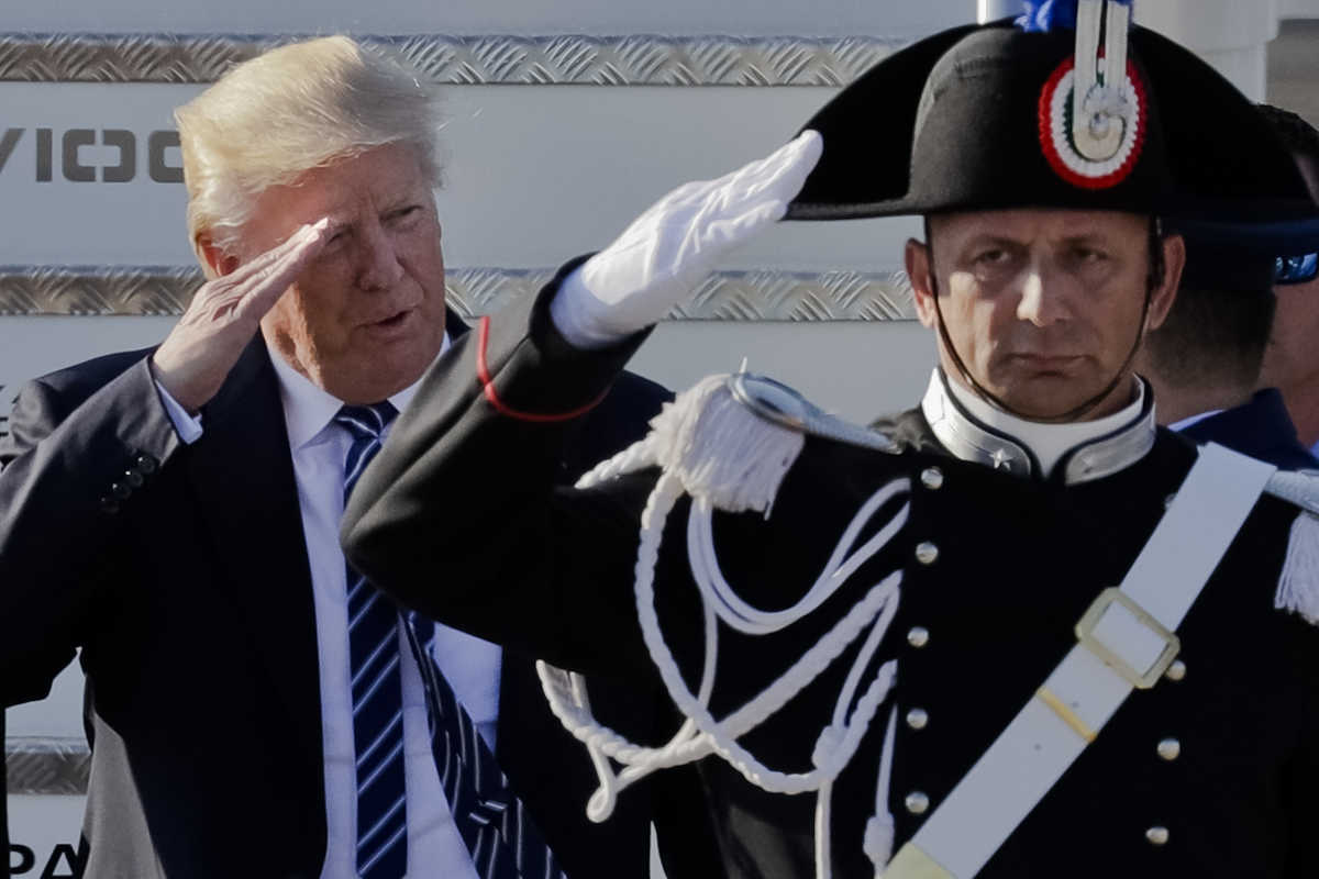 President Trump salutes a Carabinieri paramilitary officer upon his arrival at Fiumicino&amp;#039;s Leonardo Da Vinci International airport, near Rome, on Tuesday.<br />