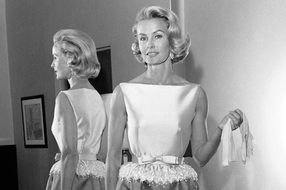 In this April 6, 1962 file photo, socialite-actress Dina Merrill models the gown she will wear at the Academy Awards presentation in Los Angeles. Merrill, the rebellious heiress who defied her super-rich parents to become an actress, died at age 93.