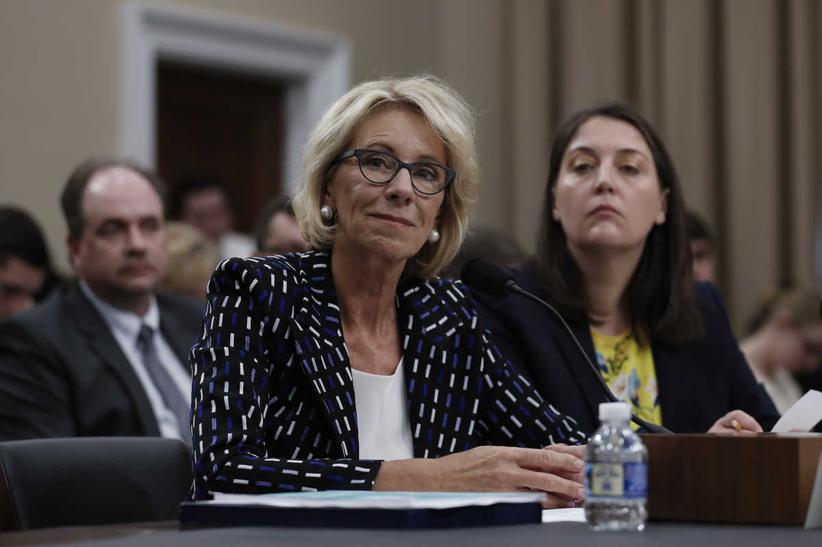 Education Secretary Betsy DeVos (left), joined by Education Department Budget Service Director Erica Navarro, testifies Wednesday on Capitol Hill.<br />
