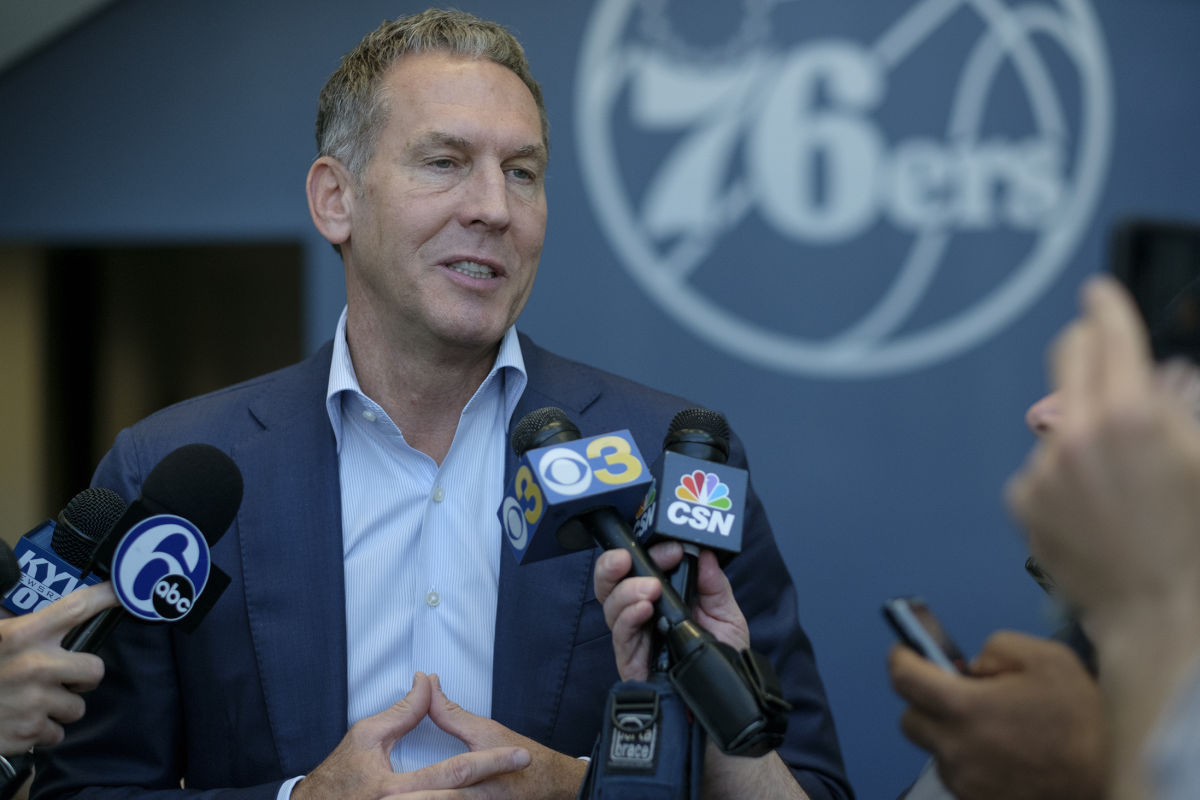 Sixers president of basketball operations Bryan Colangelo talks to reporters.