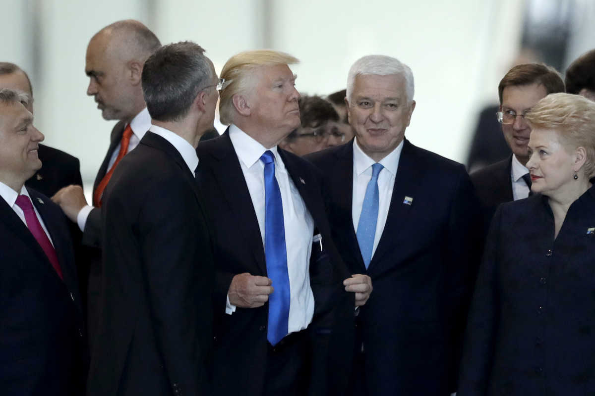 Montenegro Prime Minister Dusko Markovic (center right), after appearing to be pushed by Donald Trump during a NATO summit of heads of state and government in Brussels on Thursday.<br />