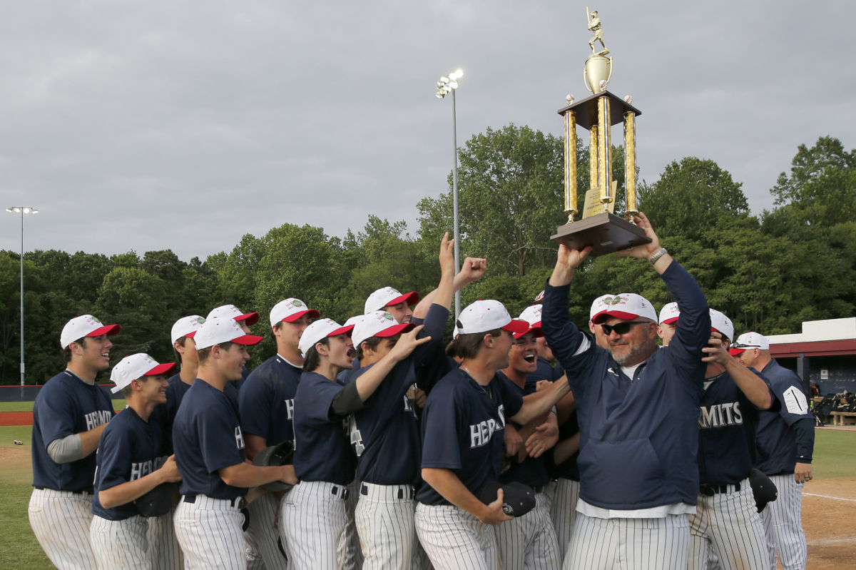 St. Augustine coach Mike Bylone holds up the trophy after his team won the Diamond Classic championship in May.