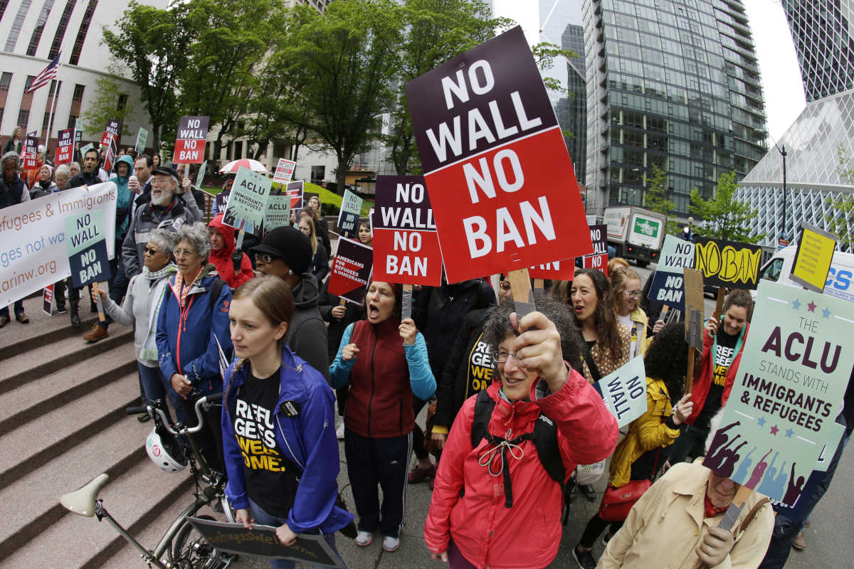 Protesters wave signs and chant during a demonstration against President Trump´s revised travel ban on May 15 outside a federal courthouse in Seattle.