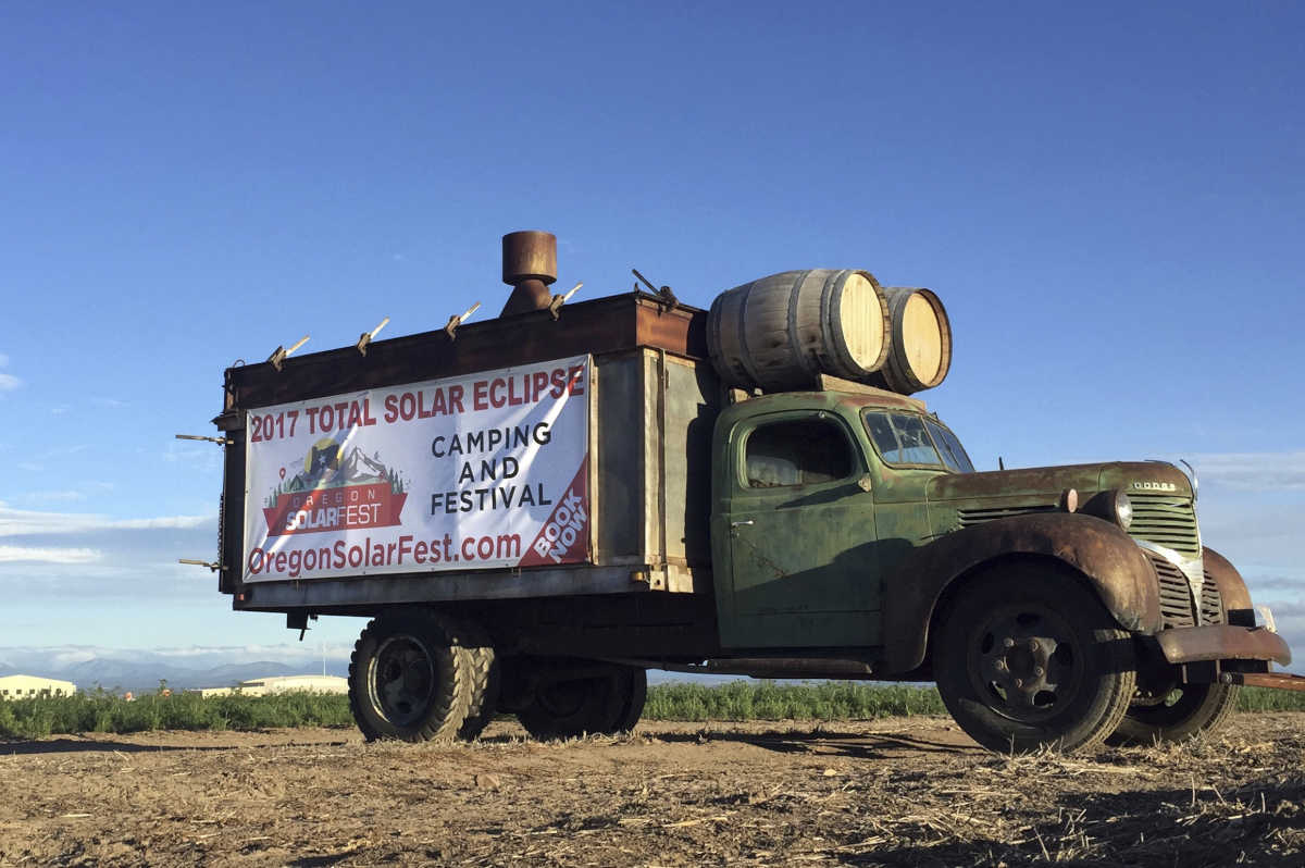 An ad for a festival planned around the celestial event posted on a busy road leading into Madras, Ore., a likely prime spot for viewing the total solar eclipse Aug. 21.<br />