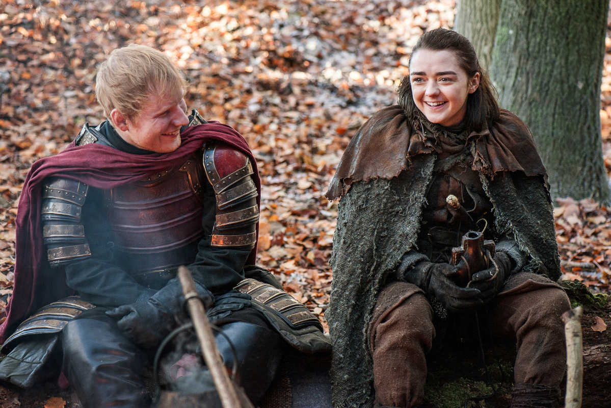 Ed Sheeran and Maisie Williams in a scene from &quot;Game of Thrones.&quot; Sheeran appeared as a Lannister soldier leading a group in song in the season premiere of the hit HBO fantasy drama.<br />