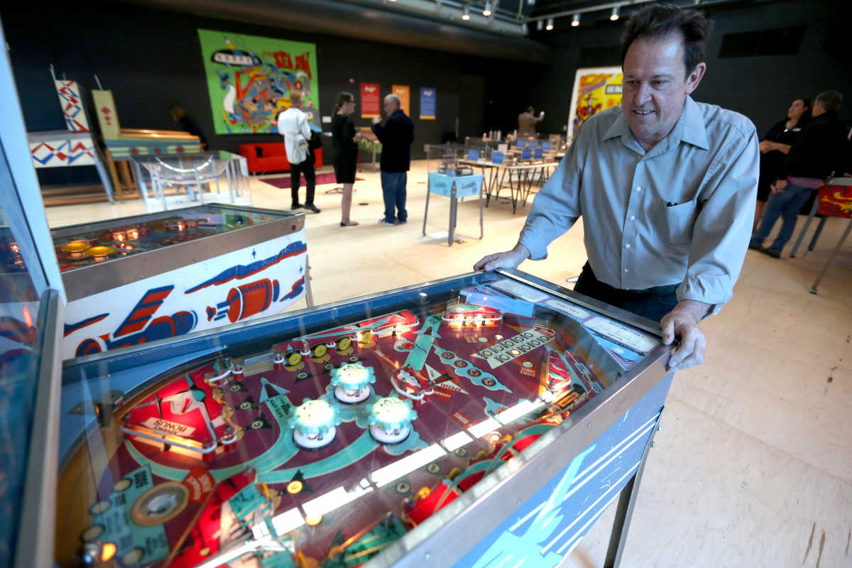 "Michael Schiess, Pacific Pinball Museum founder, demonstrates one of the museum's pinball machines. Schiess and his wife, Melissa Harmon, have collected over 1,300 machines and opened the museum in 2004, originally calling it ""Lucky JuJu."""